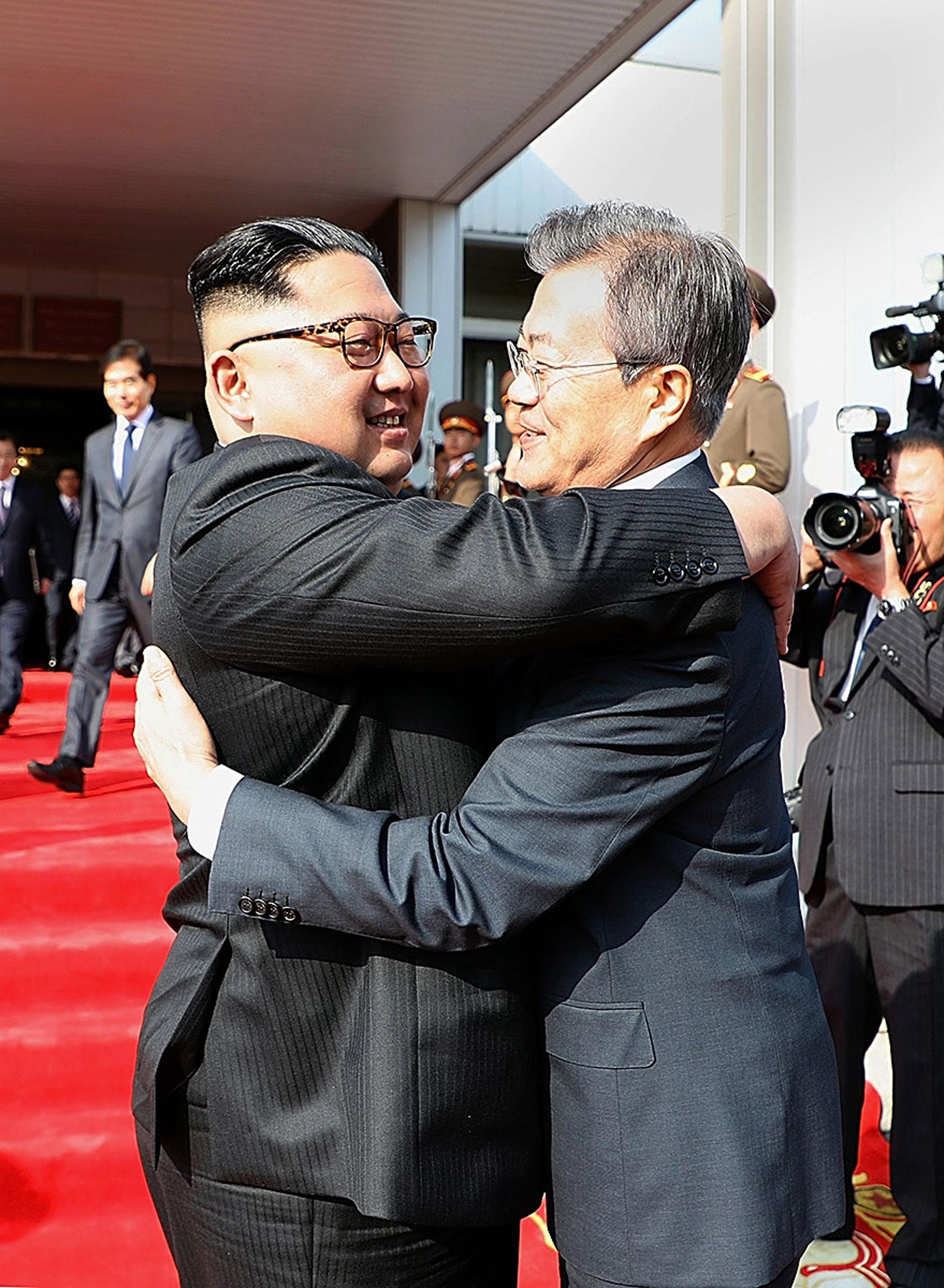 In this handout image provided by South Korean Presidential Blue House, South Korean President Moon Jae-in (R) hugs with North Korean leader Kim Jong Un (L) before their meeting on May 26, 2018 in Panmunjom, North Korea.