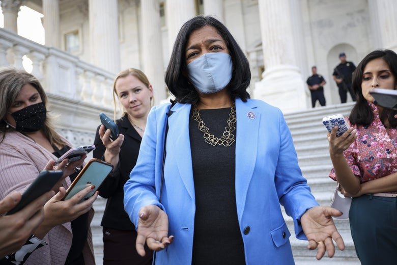 Jayapal in a mask speaks to reporters on the Capitol steps
