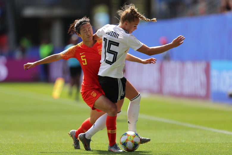 Giulia Gwinn of Germany battles for possession with Haiyan Wu of China