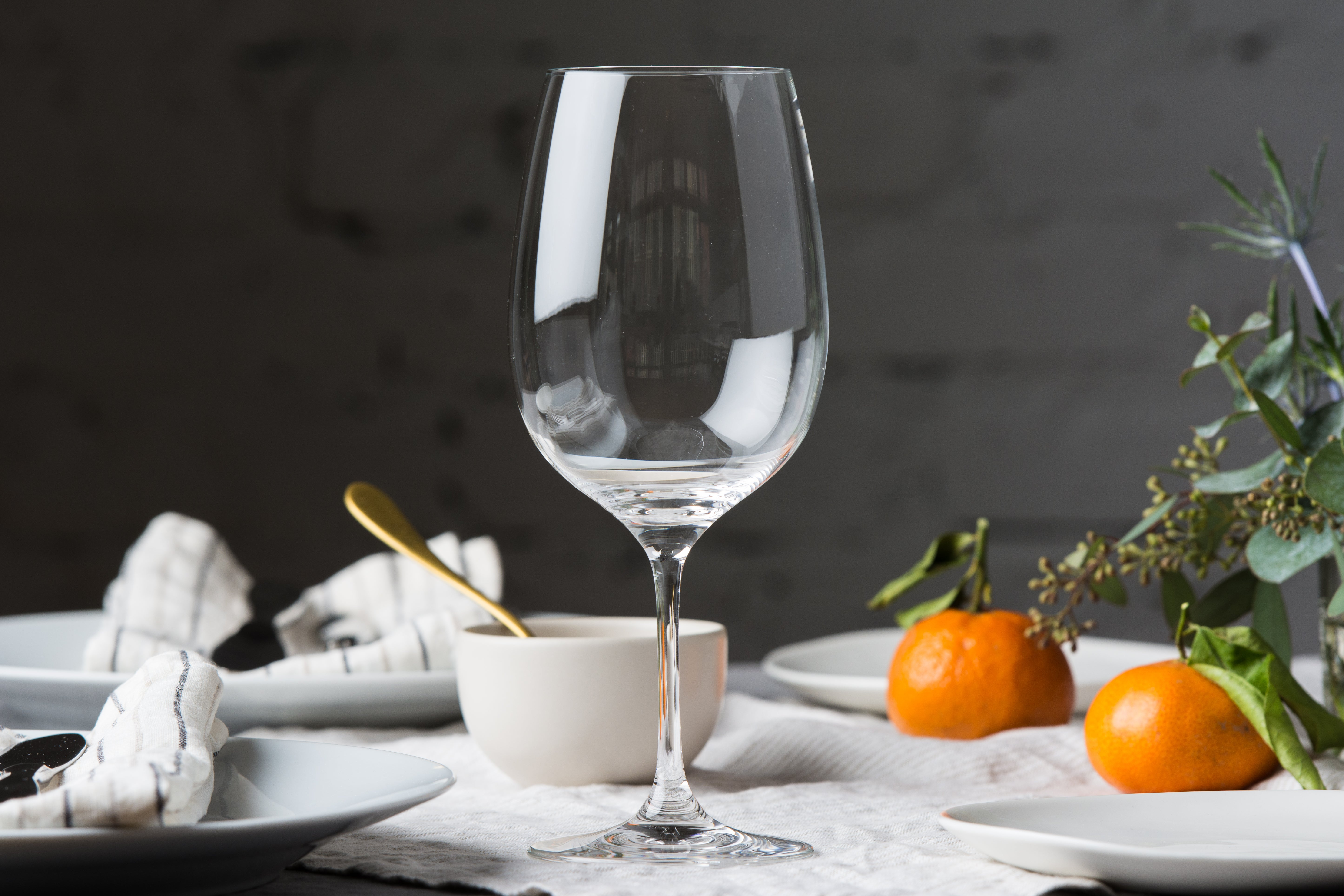 The Riedel Vinum Zinfandel/Riesling Grand Cru wine glass on a dinner table