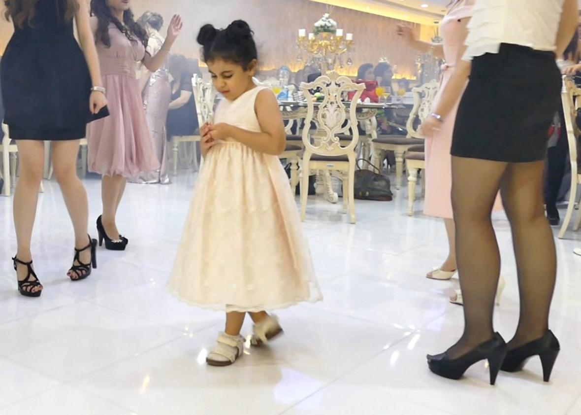 A little girl steals the show on the dance floor. Children can be photographed nearly as much as the bride at weddings.