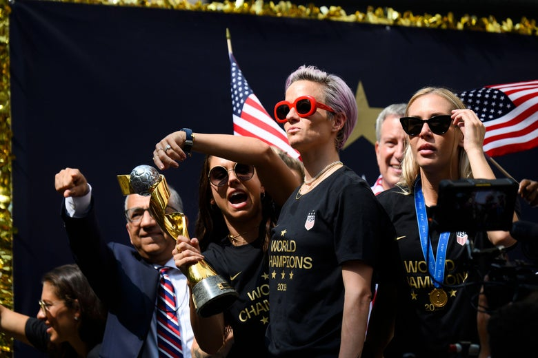 Megan Rapinoe and her teammates celebrate at the ticker-tape parade in New York.