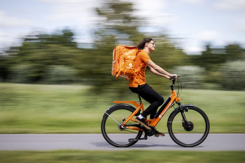 A man rides an e-bike as he delivers food.