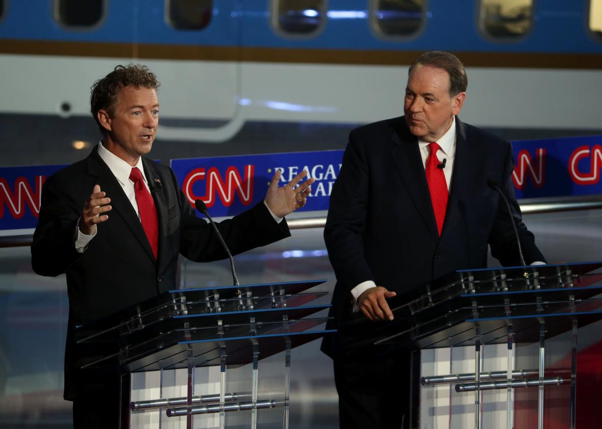 Rand Paul (R-KY) and Mike Huckabee take part in the presidential debates at the Reagan Library on September 16, 2015 in Simi Valley, California
