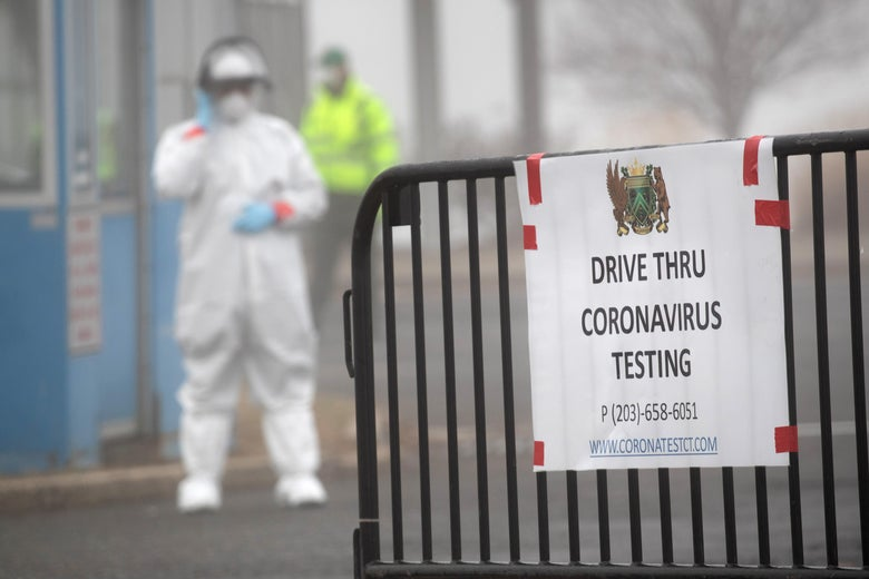 A sign sits on a barrier at a coronavirus (COVID-19) drive thru testing location operated by Murphy Medical Associates at Cummings Park on March 20, 2020 in Stamford, Connecticut.