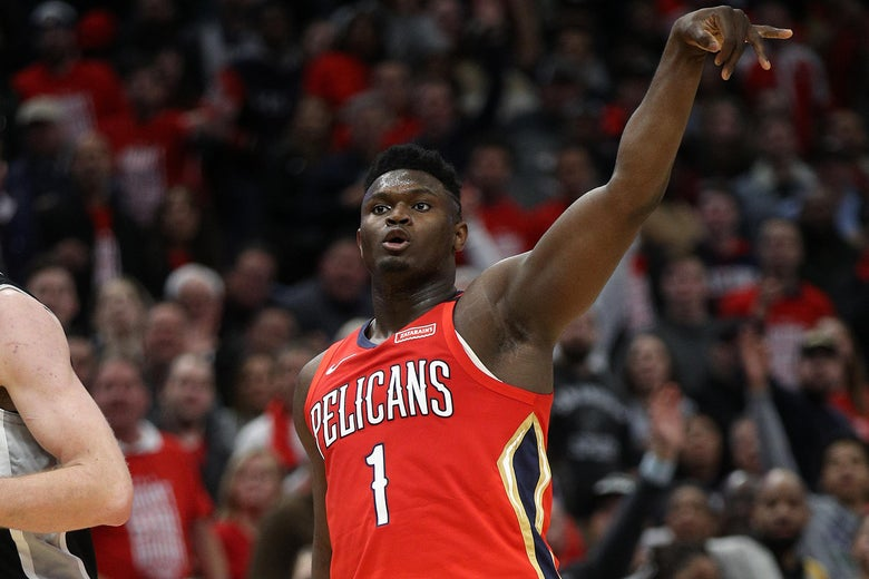 NEW ORLEANS, LOUISIANA - JANUARY 22: Zion Williamson #1 of the New Orleans Pelicans reacts after making a three point shot against the San Antonio Spurs  at Smoothie King Center on January 22, 2020 in New Orleans, Louisiana. NOTE TO USER: User expressly acknowledges and agrees that, by downloading and/or using this photograph, user is consenting to the terms and conditions of the Getty Images License Agreement.   (Photo by Chris Graythen/Getty Images)