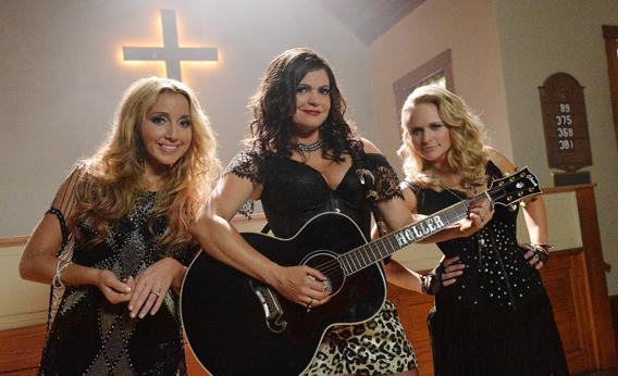 """Ashley Monroe, Anagleena Presley and Miranda Lambert (Pistol Annies) on the set, just in time for the release of their sophomore album, Annie Up, Pistol Annies unveil the brand new music video for their single """"Hush Hush."""""""