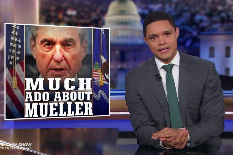 """Trevor Noah sits at an anchor desk in front of a chyron reading """"Much Ado About Mueller."""""""