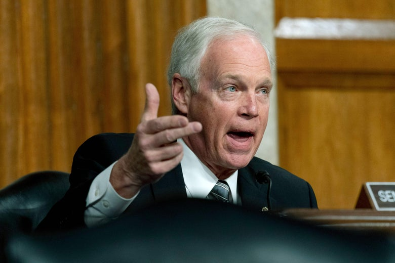 Ron Johnson gestures while speaking in a hearing.