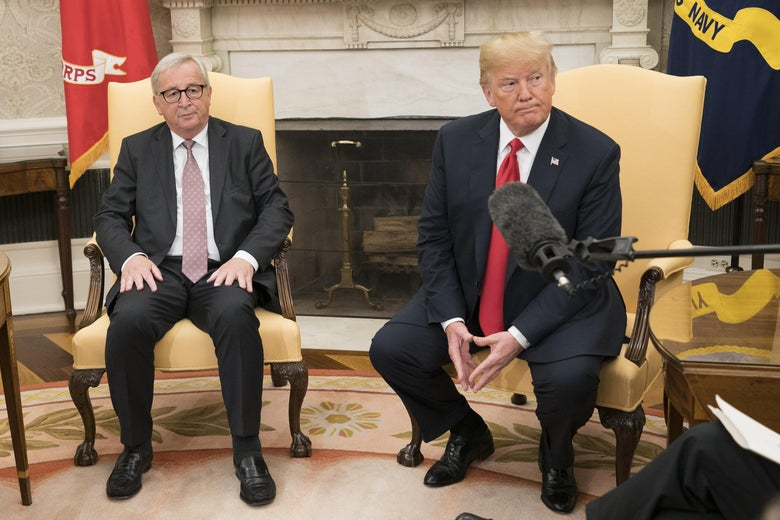 President Trump sits in the Oval Office next to President of the European Commission Jean-Claude Juncker during a press availability.