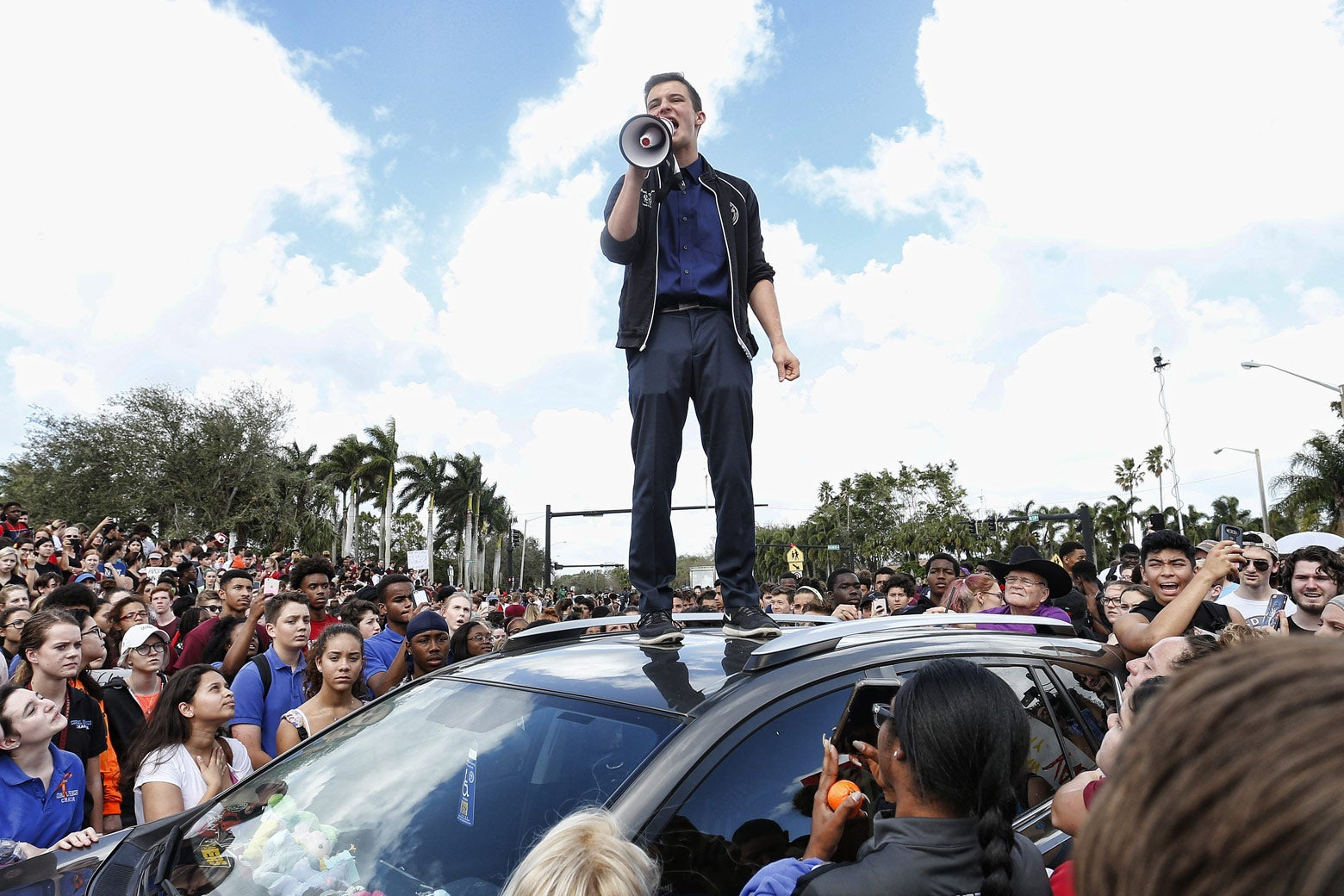 Majory Stoneman High School student Cameron Kasky addresses students as they rally after participating in a countywide school walkout in Parkland, Florida, on Wednesday.
