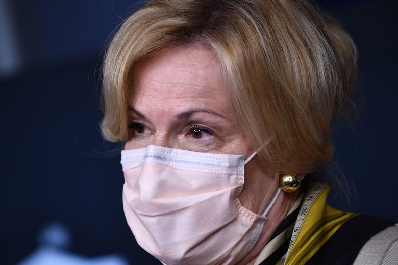 A close-up of Deborah Birx, wearing a surgical mask and one of her trademark scarves.