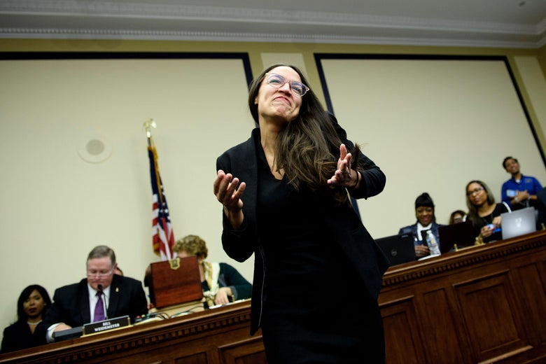 Representative-elect Alexandria Ocasio-Cortez (D-NY) reacts after drawing a lottery number for her new office on Capitol Hill November 30, 2018 in Washington, D.C.