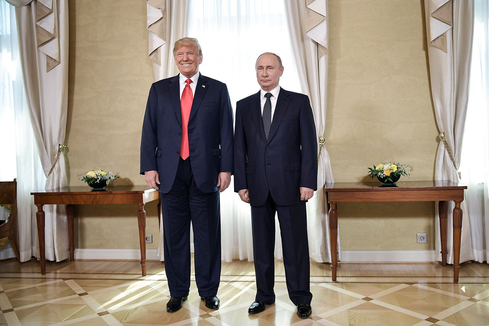President Donald Trump and Russia's President Vladimir Putin pose ahead of a meeting in Helsinki, on July 16.