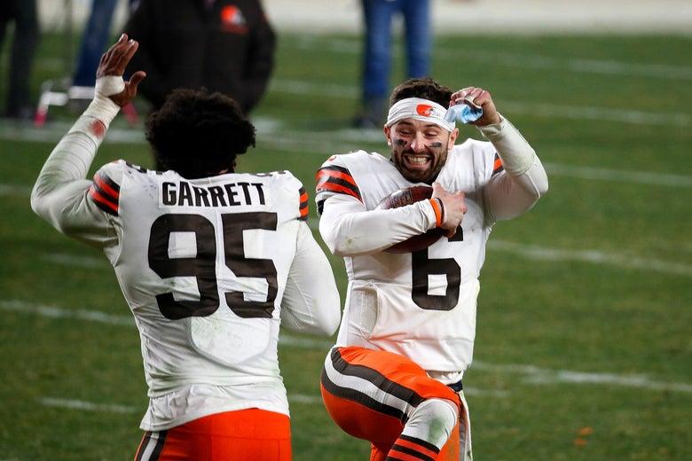 Baker Mayfield and Myles Garrett celebrate on the field