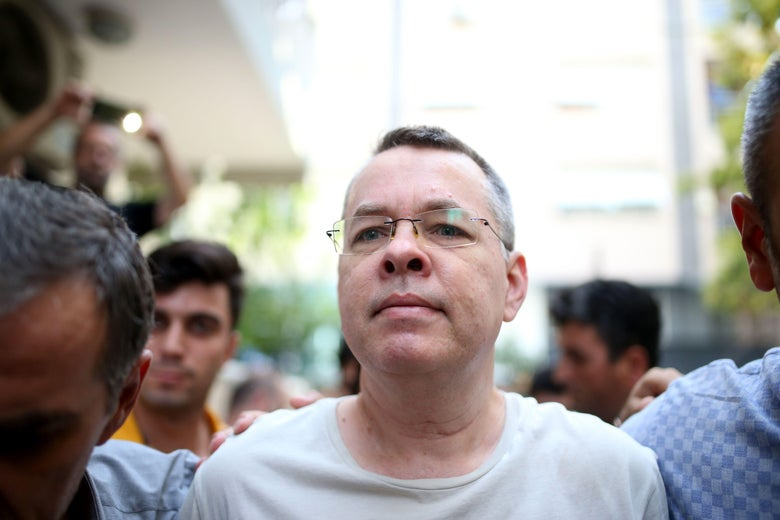 Andrew Craig Brunson escorted by Turkish plainclothes police officers