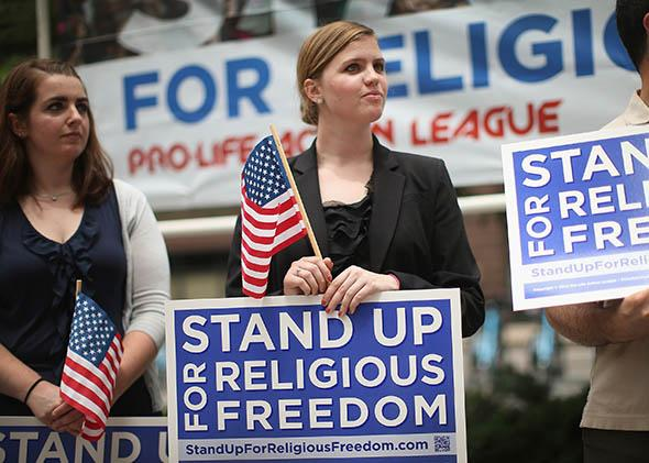 Religious freedom supporters hold a rally to praise the Supreme Court's decision in the Hobby Lobby.