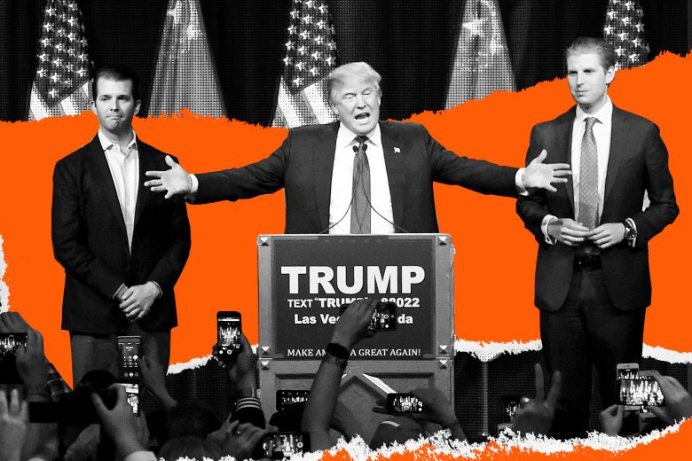 Donald Trump spreads his arms wide behind a podium that says TRUMP. His sons Donald Trump Jr. and Eric Trump stand beside him.