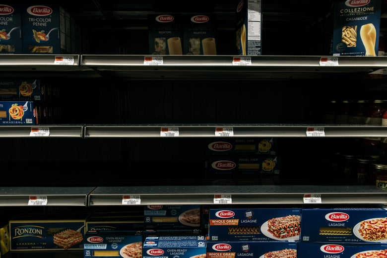 Nearly empty pasta shelves at a supermarket in Brooklyn.