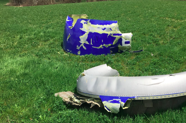 Two engine fragments on a grass field.