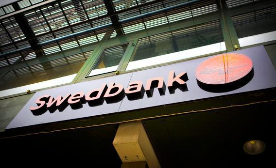 A sign hangs from a branch of Swedbank AB in Stockholm, Sweden, in 2010.