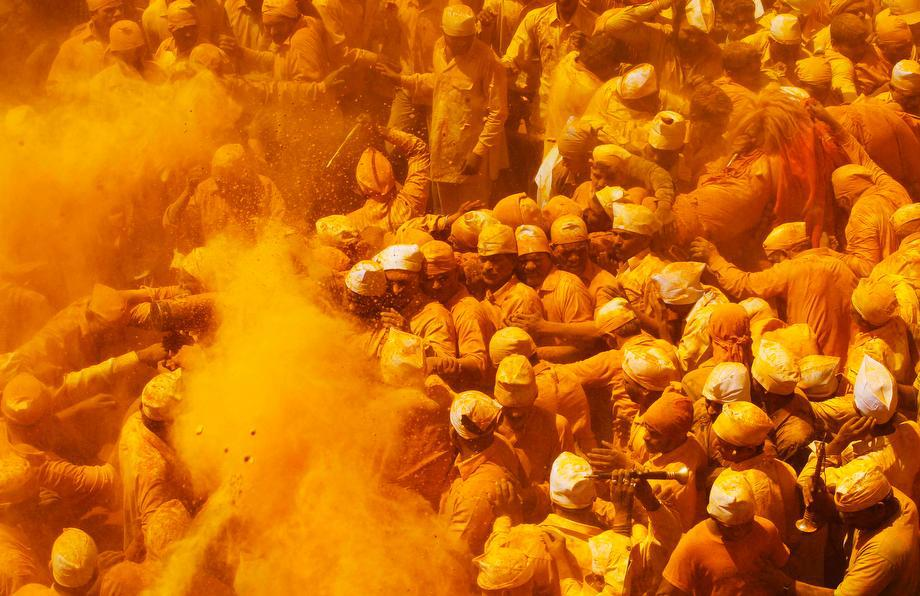 "Devotees throw turmeric powder as an offering to the shepherd god Khandoba on ""Somavati Amavasya"" at the Jejuri temple in Pune district, Maharashtra state, India, on March 11, 2013. ""Somavati Amavasya"" is when a New Moon falls on a Monday."