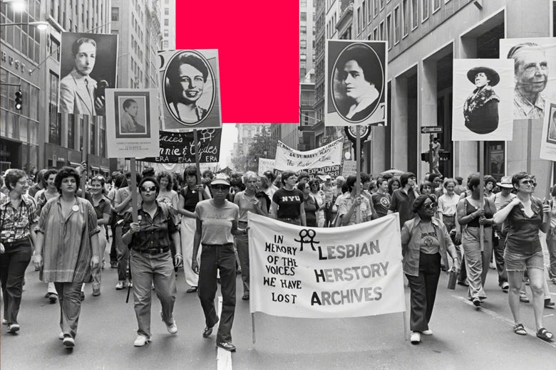 People marching in the Pride Parade circa 1980 in New York City. In the center, two people hold a banner for Lesbian Herstory Archives; others hold up posters of LGBTQ icons.