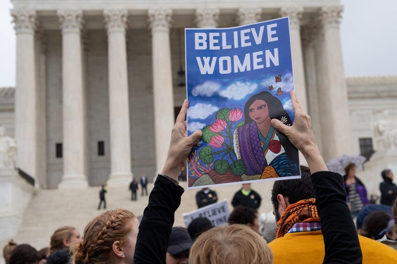 Demonstrators protest against the nomination of Judge Brett Kavanaugh to the Supreme Court.