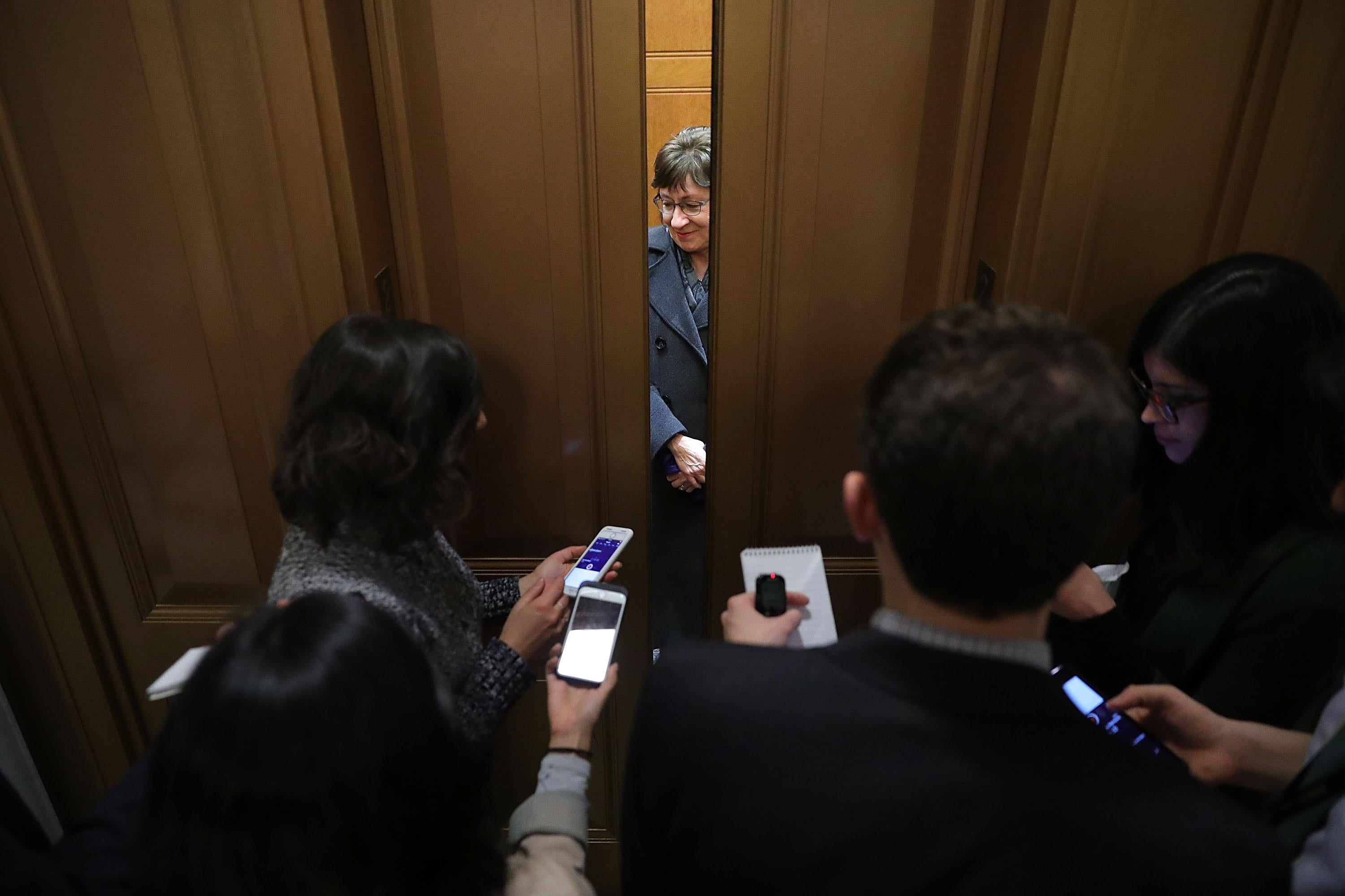 Elevator doors close as Sen. Susan Collins finishes talking to reporters on Capitol Hill.