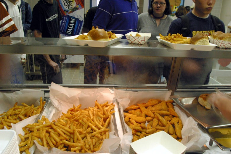 Students line up to receive food during lunch in the cafeteria at Bowie High School March 11, 2004 in Austin, Texas.