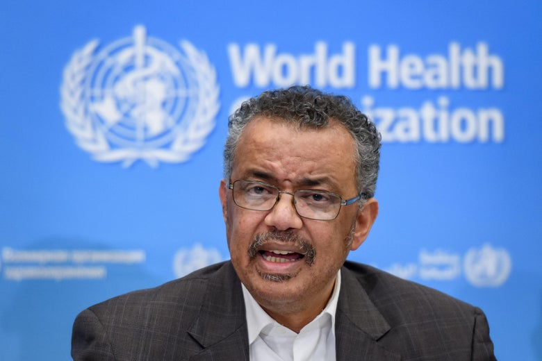 Tedros Adhanom Ghebreyesus in front of a World Health Organization–branded backdrop.