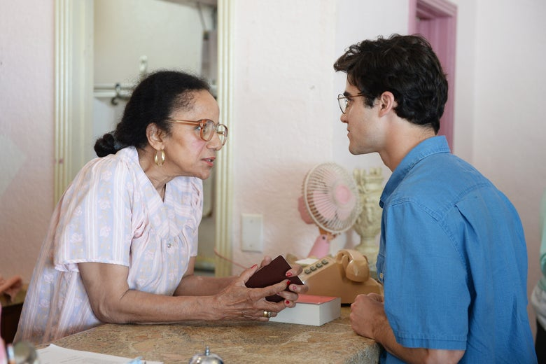 Andrew Cunanan (Darren Criss) checks in at the Normandy Plaza.