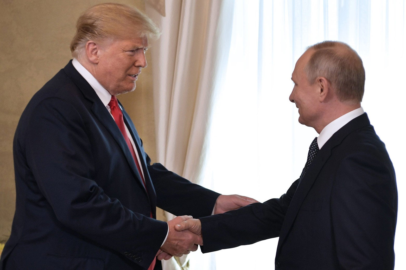 U.S. President Donald Trump shakes hands with Russia's President Vladimir Putin on July 16.