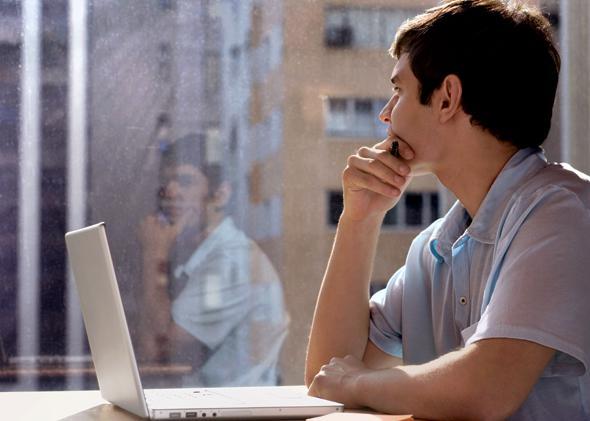 Atheist man on computer.