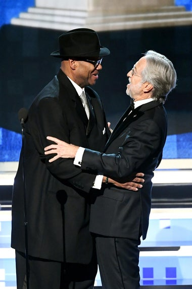 Jimmy Jam (L) and President and CEO of The Recording Academy Neil Portnow speak onstage during the 61st Annual GRAMMY Awards at Staples Center on February 10, 2019 in Los Angeles, California.  (Photo by Kevin Winter/Getty Images for The Recording Academy)