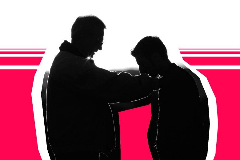 A silhouette of a father resting his hand on his son's shoulder.