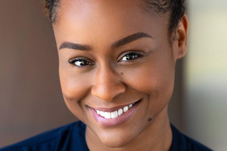 A photo of Kyla Jenee Lacey, smiling.