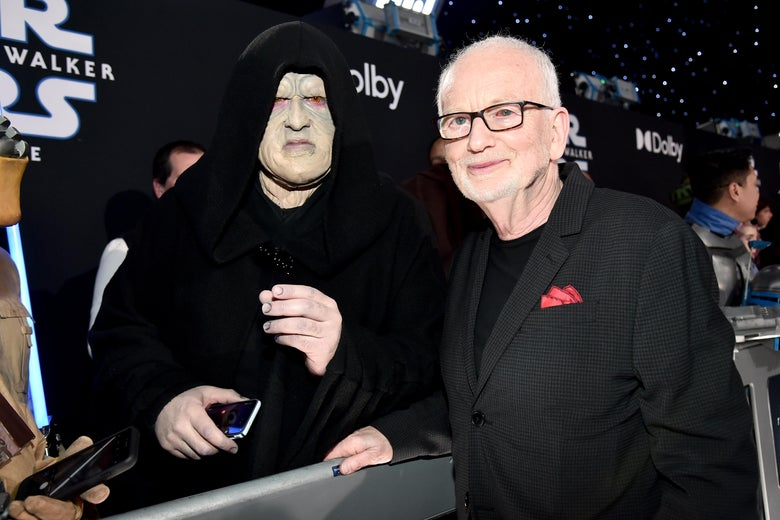 Ian McDiarmid greets a fan dressed as the Emperor on the red carpet at the premiere of Star Wars: The Rise of Skywalker.