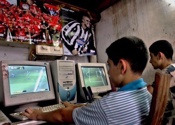 Palestinian young men at an Internet cafe in the West Bank city of Nablus, June 2006.