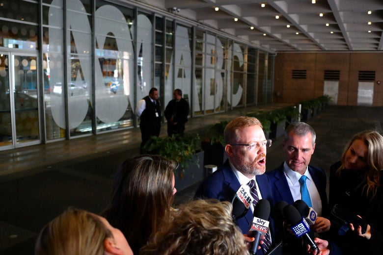 Craig McMurtrie, editorial director of the Australian Broadcasting Corporation, speaks to members of the media outside the ABC building.