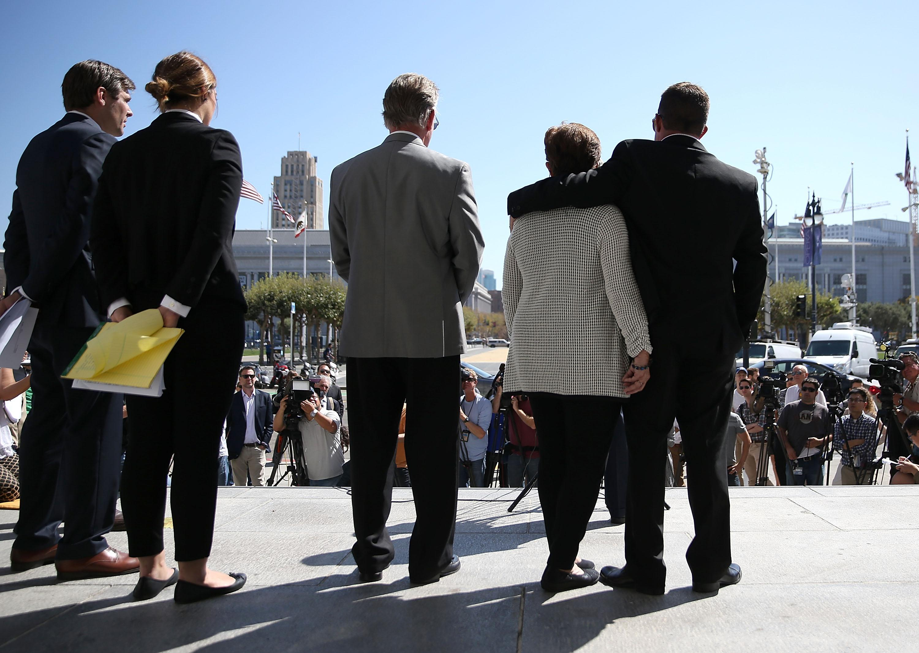 SAN FRANCISCO, CA - SEPTEMBER 01:  (R-L) Brad Steinle, Liz Sullivan and Jim Steinle, the family of Kate Steinle who was killed by an undocumented immigrant, look on during a news conference on September 1, 2015 in San Francisco, California. The family of Kate Steinle who was killed by an undocumented immigrant, have filed claims against San Francisco Sheriff Ross Mirkarimi, the Bureau of Land Management and Immigration and Customs Enforcement for their role in their daughter's death.  (Photo by Justin Sullivan/Getty Images)