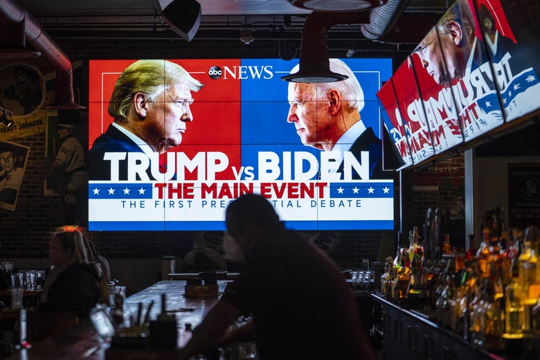 "A giant TV screen in a bar promotes the first ""Trump vs. Biden"" presidential debate."