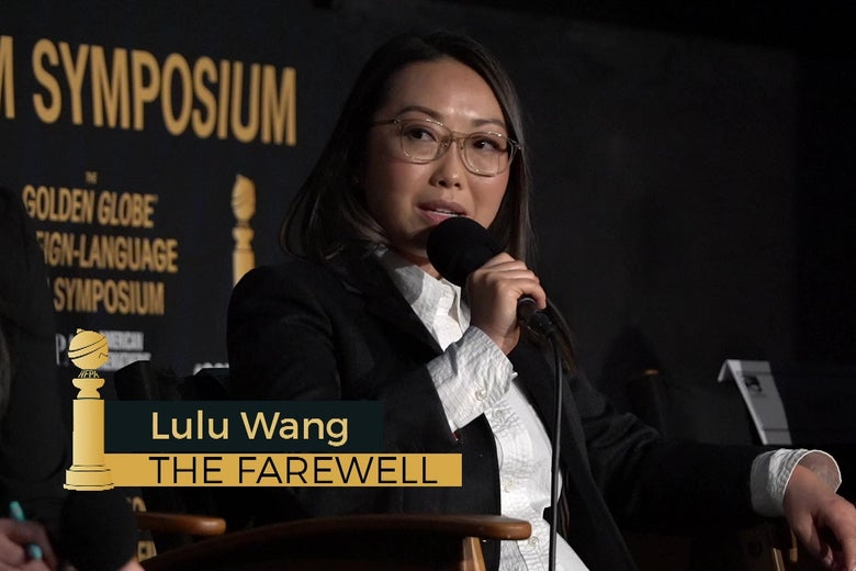 Lulu Wang sitting in a director's chair answering questions on stage at the Egyptian Theatre.