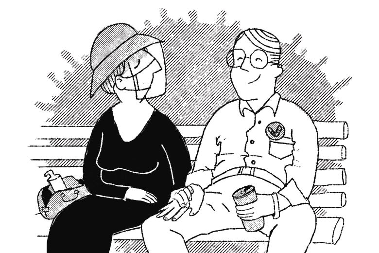 A couple sitting on a park bench, the woman still in full protective gear as the man basks in the sun without a mask, drinking a soda.