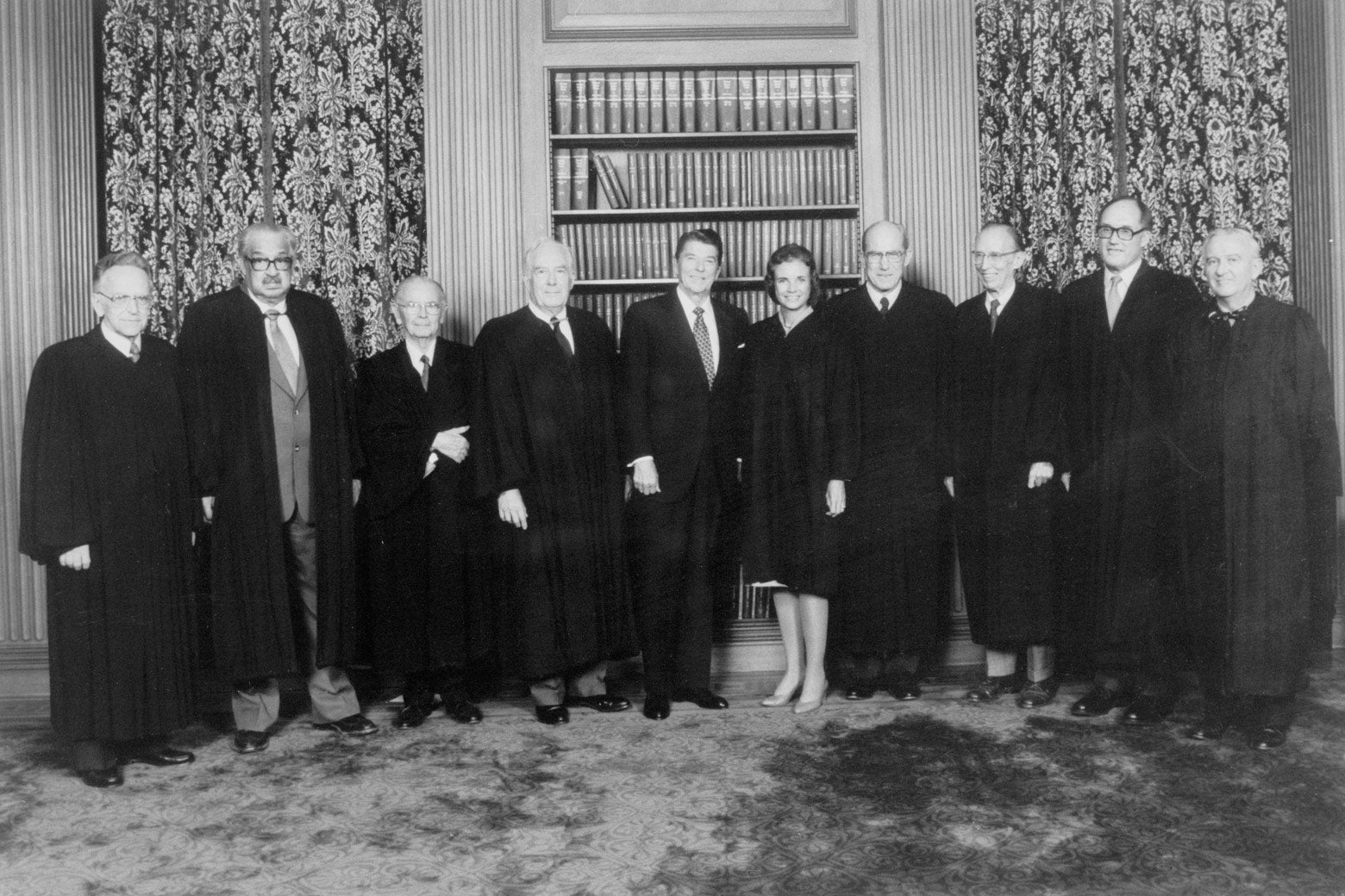 Justices Harry Blackmun, Thurgood Marshall, William Brennan, Warren Burger, President Ronald Reagan, Justice Sandra O'Connor, Justices Byron White, Lewis Powell, William Rehnquist and John Paul Stevens.