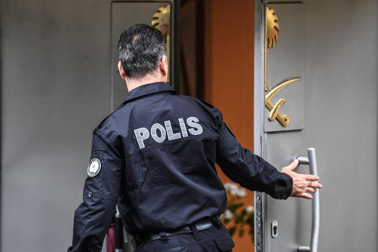A Turkish policeman stands in front of the door at the Saudi consulate in Istanbul.