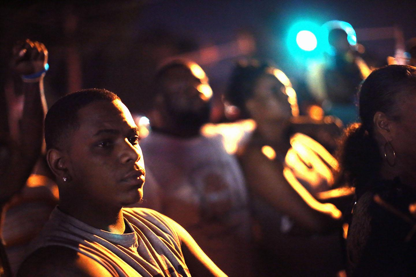 Demonstrators protest the killing of teenager Michael Brown.