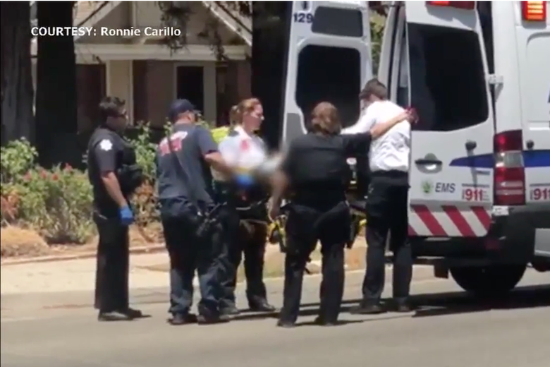 Screenshot from a news report on local ABC affiliate KFSN show paramedics loading the two-year-old into an ambulance on July 8, 2018 in Fresno, California.