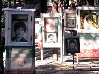 Many graves are draped in the Iranian flag