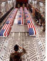 """Flag-draped """"coffins"""" of U.S. casualties from Iraq          Click image to expand."""